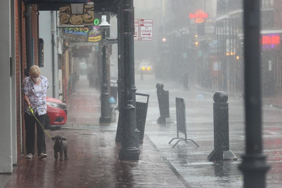 A woman walks her dog in New Orleans as Hurricane Ida closed in. Source: Getty