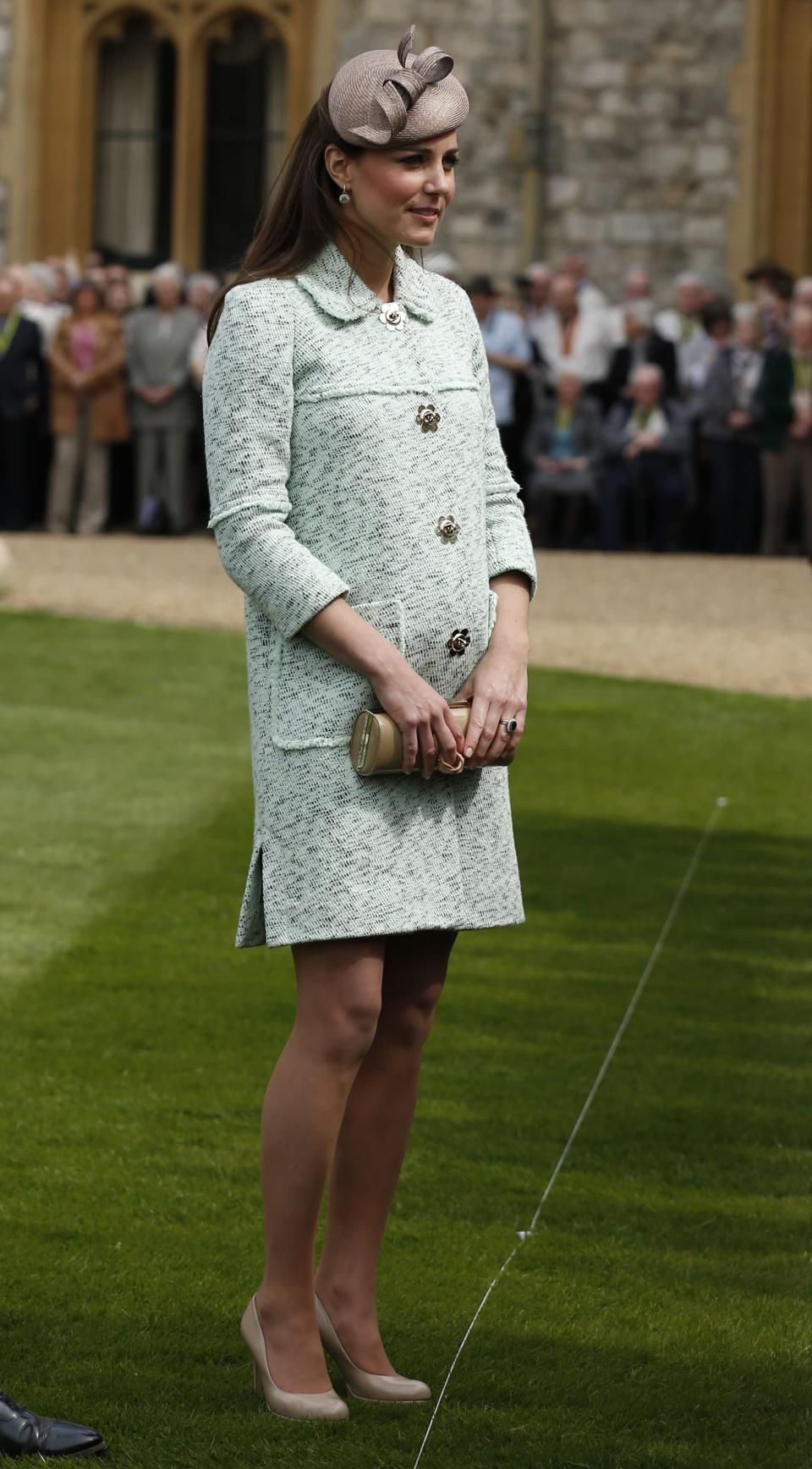 <p>Kate donned a bouclé-effect coat by Mulberry for The National Review of Queen's Scouts in April, 2013. She accessorised the look with taupe heels by LK Bennett. <em>[Photo: Getty]</em> </p>