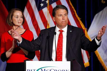 North Carolina Governor Pat McCrory tells supporters that the results of his contest against Democratic challenger Roy Cooper will be contested, while his wife Ann looks on, in Raleigh, North Carolina, U.S. November 9, 2016.  REUTERS/Jonathan Drake/File Photo
