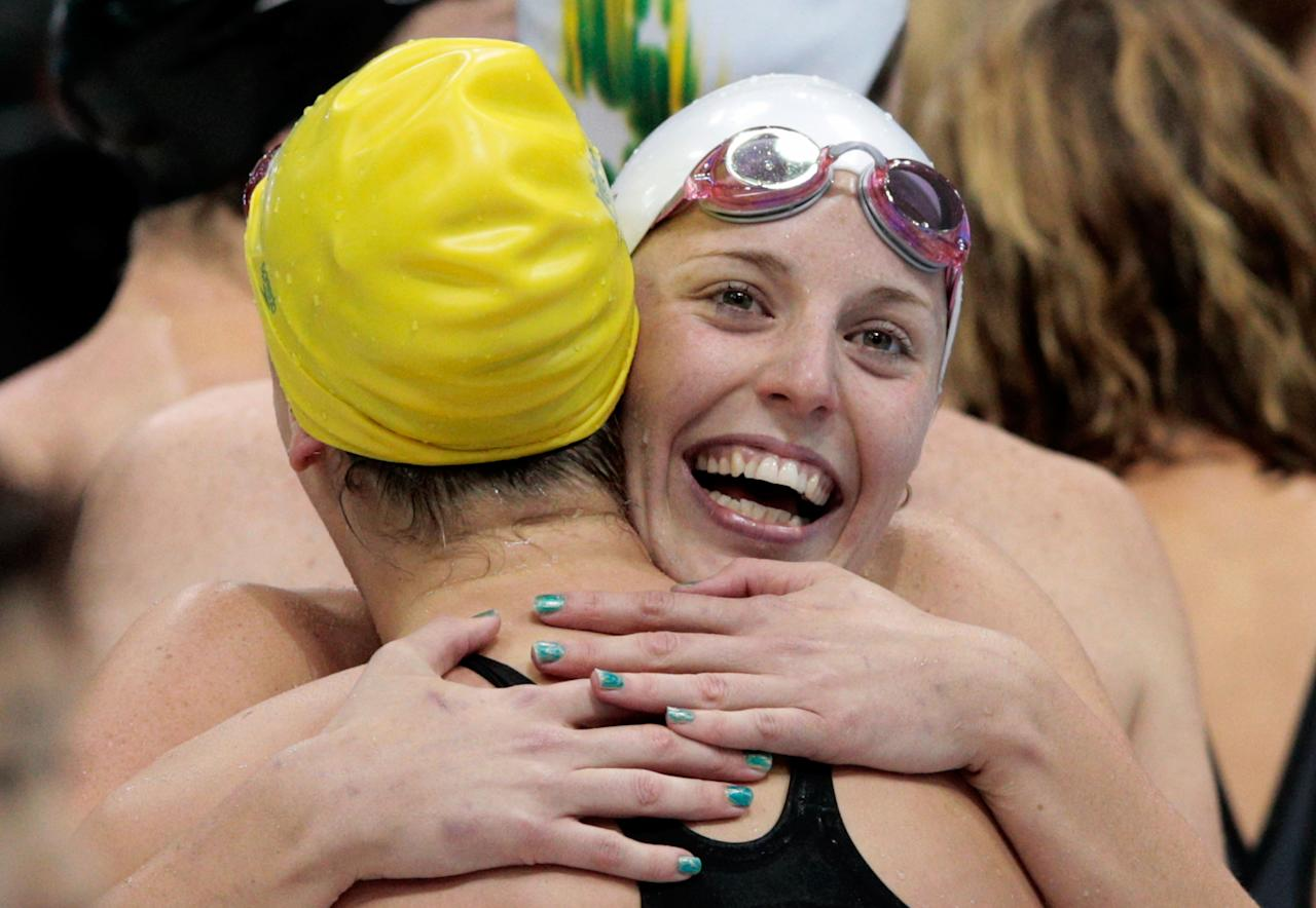 LONDON, ENGLAND - JULY 28:  (from R) Alicia Coutts and Brittany Elmslie of Australia celebrate after they won the Final of the Women's 4x100m Freestyle Relay on Day 1 of the London 2012 Olympic Games at the Aquatics Centre on July 28, 2012 in London, England.  (Photo by Adam Pretty/Getty Images)