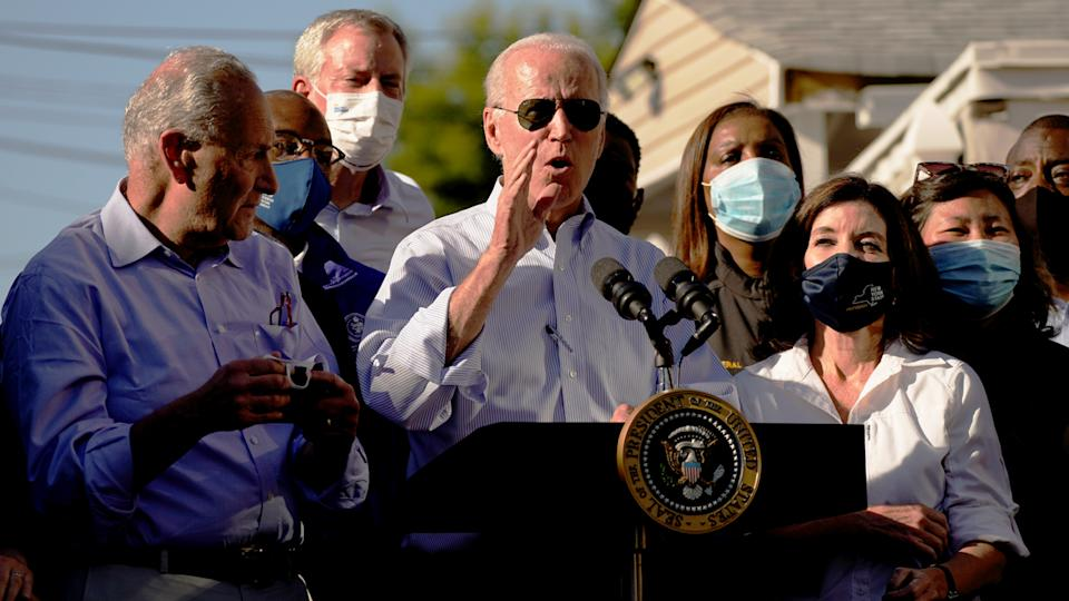 President Biden speaks as Gov. Kathy Hochul of New York, right, and Senate Majority Leader Chuck Schumer, left, look on in Queens, N.Y., on Tuesday.