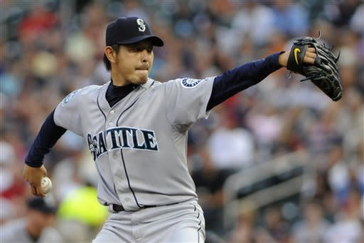 Seattle Mariners pitcher Hisashi Iwakuma, of Japan, throws against the Minnesota Twins in the first inning of a baseball game, Tuesday, Aug. 28, 2012, in Minneapolis. (AP Photo/Jim Mone)