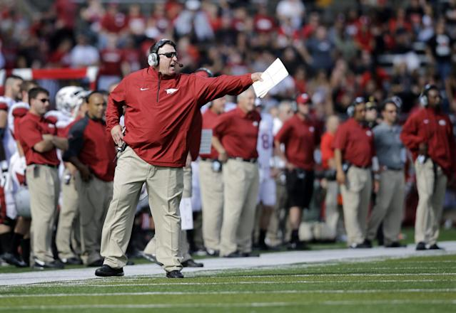 Arkansas head coach Bret Bielema reacts to a play during the first half of an NCAA college football game against Rutgers in Piscataway, N.J., Saturday, Sept. 21, 2013. Rutgers won 28-24. (AP Photo/Mel Evans)