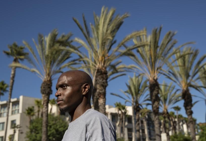 LOS ANGELES, CA -JULY 30, 2020: Roderick Thompson Sr. 35, who was released 9 months early from Avenal State Prison due to the coronavirus outbreak, is photographed outside of Union Station in downtown Los Angeles after arriving there this afternoon on an Amtrak bus. Thompson Sr. had been incarcerated at Avenal State Prison for the past 3 and 1/2 years and was released this morning. He took the train from Hanford to Bakersfield and the bus from Bakersfield to Union Station. (Mel Melcon / Los Angeles Times)