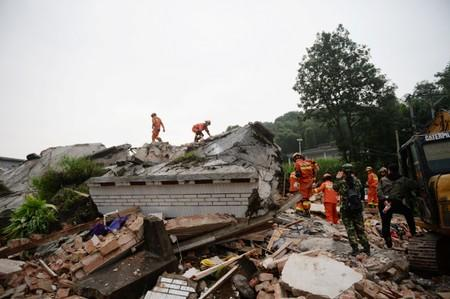 Rescue workers search for survivors in the rubble after earthquakes hit Changning county in Yibin