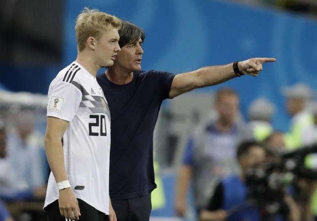 Germany head coach Joachim Loew instructs Julian Brandt during the group F match between Germany and Sweden at the 2018 soccer World Cup in the Fisht Stadium in Sochi, Russia, Saturday, June 23, 2018. (AP Photo/Michael Probst)