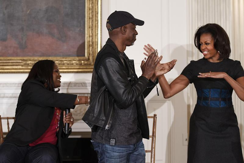 First lady Michelle Obama interacts with Blues artists Shemekia Copeland, left, and Keb Mo, center, during a student workshop celebrating Blues music, Tuesday, Feb. 21, 2012, in the State Dining Room of the White House in Washington. (AP Photo/J. Scott Applewhite)