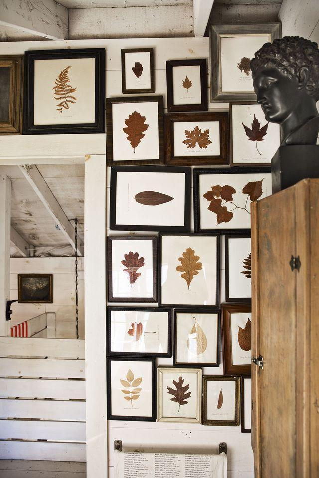 """<p>What's more """"fall"""" than some fallen leaves? Create a gallery wall of leaves in mismatched frames to bring in a cozy feel like author <a href=""""http://www.bykathleenhackett.com/"""" rel=""""nofollow noopener"""" target=""""_blank"""" data-ylk=""""slk:Kathleen Hackett"""" class=""""link rapid-noclick-resp"""">Kathleen Hackett</a> has done in her <a href=""""https://www.elledecor.com/design-decorate/room-ideas/a36792988/maine-cottage-style/"""" rel=""""nofollow noopener"""" target=""""_blank"""" data-ylk=""""slk:house in Maine"""" class=""""link rapid-noclick-resp"""">house in Maine</a>.</p>"""