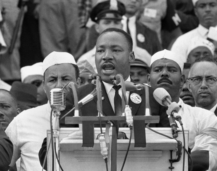 """FILE- In this Aug. 28, 1963, black-and-white file photo Dr. Martin Luther King Jr., head of the Southern Christian Leadership Conference, addresses marchers during his """"I Have a Dream"""" speech at the Lincoln Memorial in Washington. NBC News says it will rebroadcast a 1963 """"Meet the Press"""" interview with Martin Luther King Jr. in honor of the March on Washington's 50th anniversary next week. King appeared on the news program three days before his landmark """"I Have a Dream"""" speech at the civil rights march. (AP Photo/File)"""