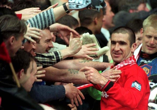 Eric Cantona is greeted by fans after Manchester United's 1996 FA Cup win