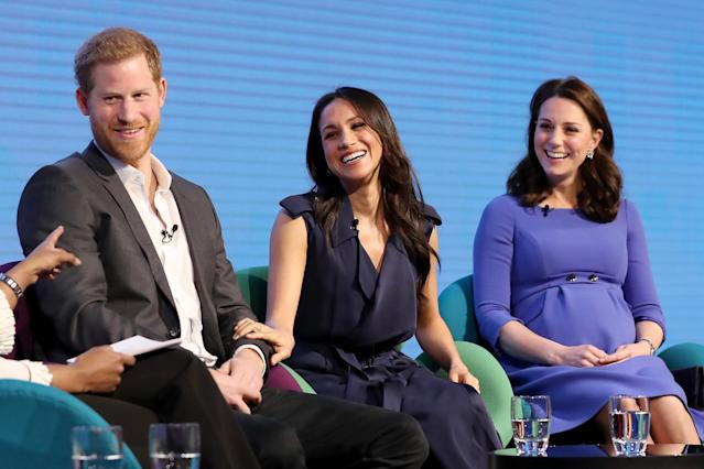 Prince Harry and Kate Middleton flank Meghan Markle, in a navy trench coat, at the first annual Royal Foundation Forum held at Aviva on Feb. 28, 2018, in London. (Photo: Chris Jackson – WPA Pool/Getty Images)