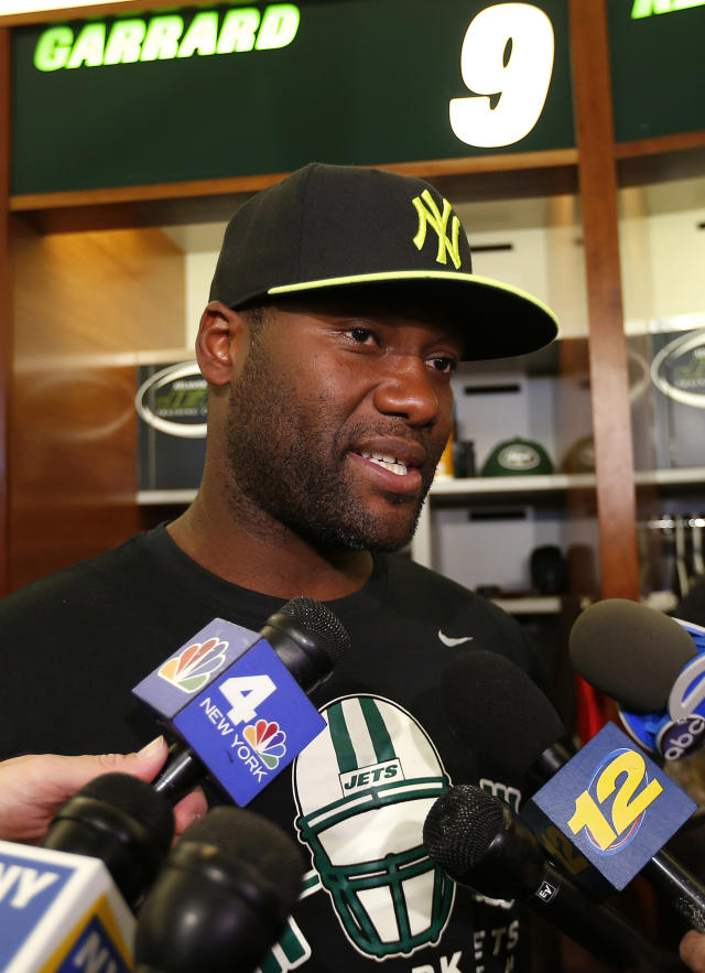 FILE - In this May 2, 2013, file photo, New York Jets quarterback David Garrard talks to reporters during a locker room availability at the team's NFL practice facility in Florham Park, N.J. After considering retirement the last few months, Garrard has re-signed with the Jets to serve as a veteran backup and mentor to rookie Geno Smith, the team announced Thursday, Oct. 10, 2013. (AP Photo/Rich Schultz, File)