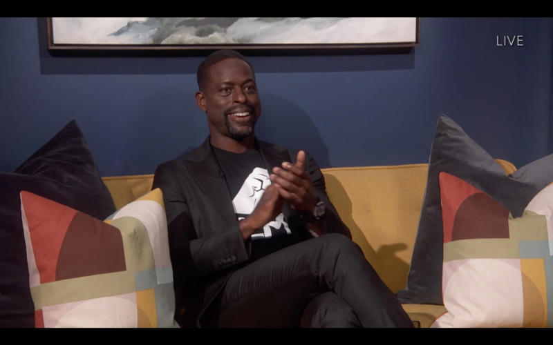 Sterling K. Brown wears a t-shirt reading BLM while presenting an award. (Photo: Getty Images)