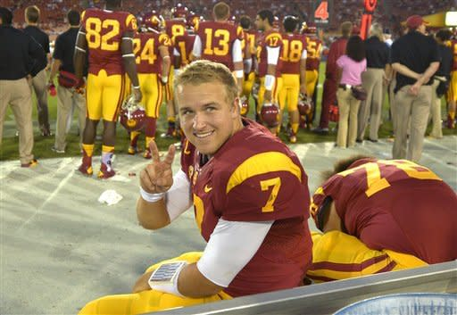 Southern California quarterback Matt Barkley gestures to fans as he sits on the bench during the second half of an NCAA college football game against Colorado, Saturday, Oct.20, 2012, in Los Angeles. (AP Photo/Mark J. Terrill)