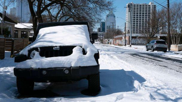 PHOTO: A parked Jeep is covered in snow Tuesday, Feb. 16, 2021, in Austin, Texas. (Ashley Landis/AP)