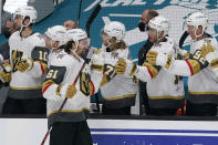 Vegas Golden Knights right wing Mark Stone (61) is congratulated by teammates after scoring a goal against the San Jose Sharks during the first period of an NHL hockey game in San Jose, Calif., Saturday, March 6, 2021. (AP Photo/Jeff Chiu)
