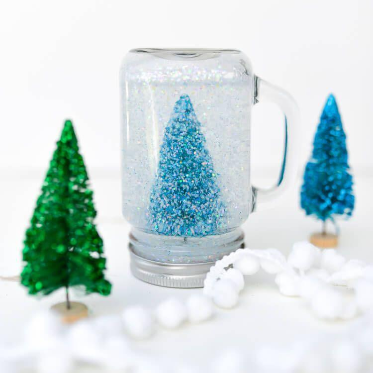 """<p>This tutorial mixes glue and water so that the glitter falls slowly, creating a magical, sparkling effect.</p><p><strong>Get the tutorial at <a href=""""https://heyletsmakestuff.com/jar-snow-globe/"""" rel=""""nofollow noopener"""" target=""""_blank"""" data-ylk=""""slk:Hey, Let's Make Stuff"""" class=""""link rapid-noclick-resp"""">Hey, Let's Make Stuff</a>.</strong></p><p><strong><a class=""""link rapid-noclick-resp"""" href=""""https://www.amazon.com/KAMOTA-Regular-Magnetic-Whiteboard-Included/dp/B07N3SXV24/ref=sr_1_1_sspa?tag=syn-yahoo-20&ascsubtag=%5Bartid%7C10050.g.23489557%5Bsrc%7Cyahoo-us"""" rel=""""nofollow noopener"""" target=""""_blank"""" data-ylk=""""slk:SHOP MASON JARS"""">SHOP MASON JARS</a><br></strong></p>"""