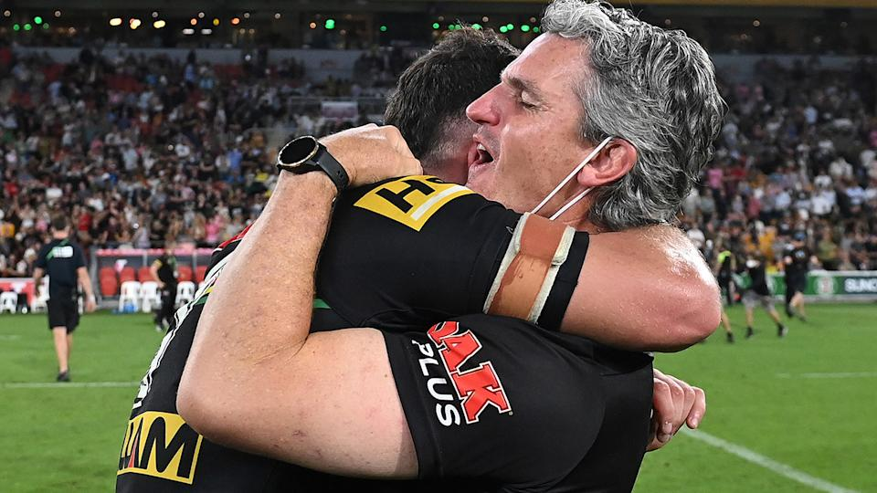 Nathan and Ivan Cleary embrace after winning the 2021 NRL grand final. (Photo by Bradley Kanaris/Getty Images)