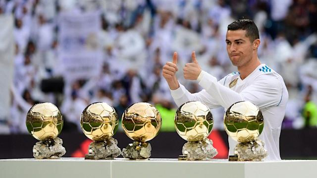<p>Ronaldo with his Ballon D'or trophies. </p>