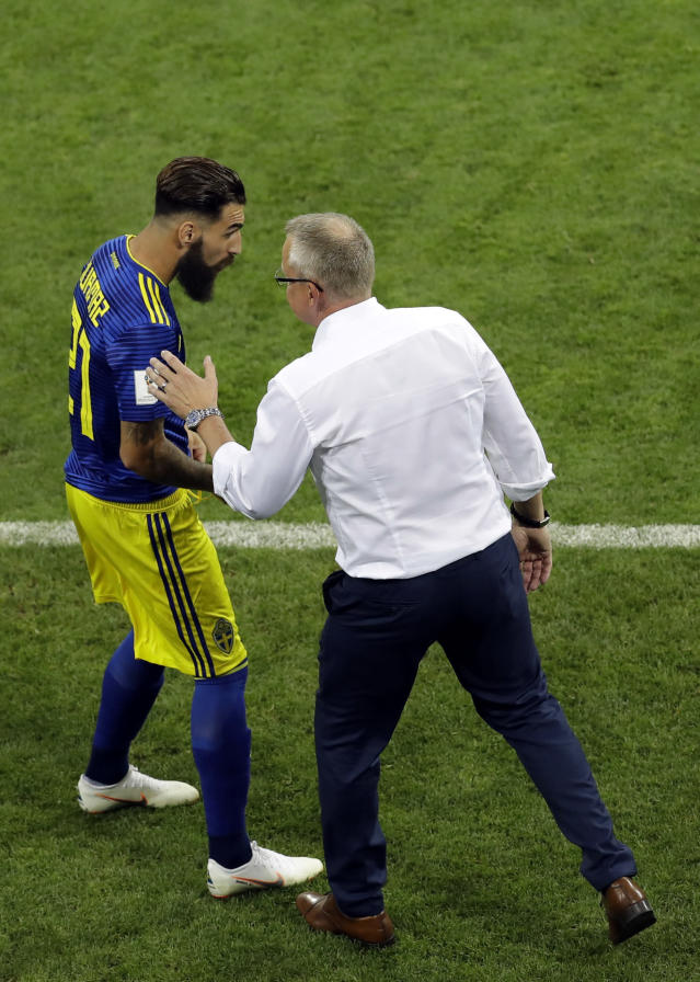 Sweden's head coach Janne Andersson, right, converses with player Jimmy Durmaz during the group F match between Germany and Sweden at the 2018 soccer World Cup in the Fisht Stadium in Sochi, Russia, Saturday, June 23, 2018. (AP Photo/Sergei Grits)