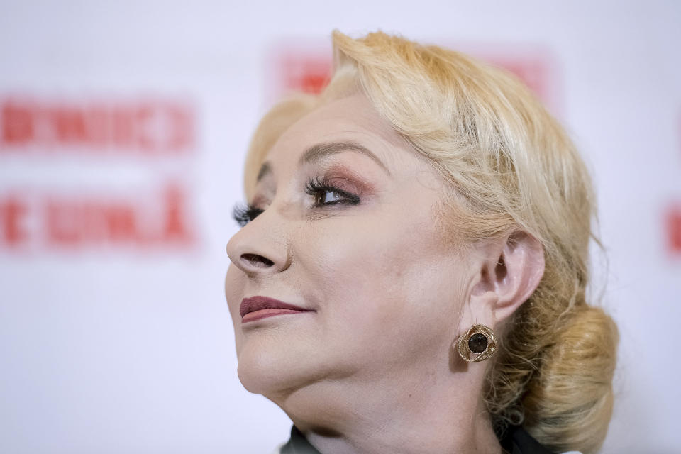 Former Romanian Prime Minister Viorica Dancila turns her head during a statement after exit polls indicate her as the runner up of the presidential race, with up to 25 percent of the votes in Bucharest, Romania, Sunday, Nov. 10, 2019. Dancila will face incumbent President Klaus Iohannis in an election runoff on Nov. 24. (AP Photo/Alexandru Dobre)