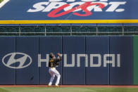 Pittsburgh Pirates center fielder Jarrod Dyson waits for the home run ball hit by Detroit Tigers' C.J. Cron as it bounces off the tarp covering seats in the outfield in the first inning of a baseball game, Saturday, Aug. 8, 2020, in Pittsburgh. (AP Photo/Keith Srakocic)