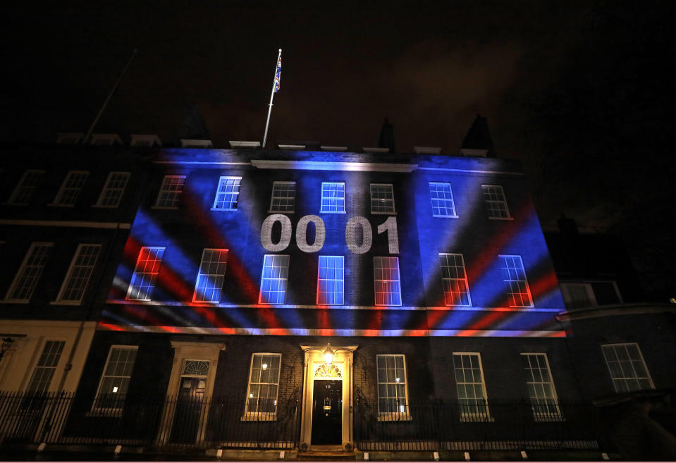 FILE - In this Friday, Jan. 31, 2020 file photo a countdown to Brexit timer and the colors of the British Union flag illuminate the exterior of 10 Downing street, the residence of the British Prime Minister, in London, England. (AP Photo/Kirsty Wigglesworth, File)