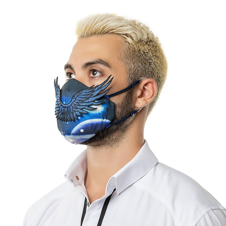 """Face masks are supposed to be utiltarian, but there's no reason they can't be stylish. This <a href=""""https://xsuit.com/collections/xmask-men/products/xmask-pro?variant=33423664152716"""" target=""""_blank"""" rel=""""noopener noreferrer"""">very expensive dragon face mask</a> will be perfect for the """"Game Of Thrones""""-loving status seeker in your life."""