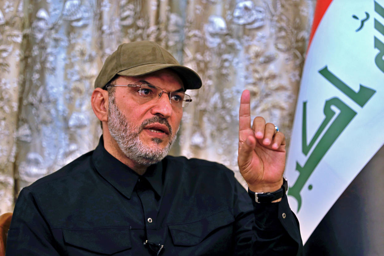Abu Alaa al-Walae, commander of Kataib Sayyid al-Shuhadam, speaks during an interview with The Associated Press, Monday, July 5, 2021, in Baghdad, Iraq. The leader of an Iran-backed Iraqi militia has vowed to retaliate against America for the death of four of his men in a U.S. airstrike along the Iraq-Syria border last month, saying it will be a military operation everyone will talk about. (AP Photo/Khalid Mohammed)