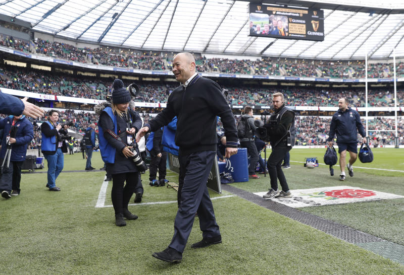 England's head coach Eddie Jones walks to take his place in the dugout before the Six Nations international rugby union match between England and Ireland at Twickenham stadium in London, Sunday, Feb. 23, 2020. (AP Photo/Alastair Grant)