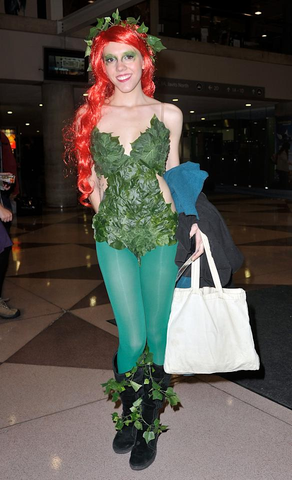 A Comic Con attendee wearing a Poison Ivy costume poses during the 2012 New York Comic Con at the Javits Center on October 11, 2012 in New York City.  (Photo by Daniel Zuchnik/Getty Images)