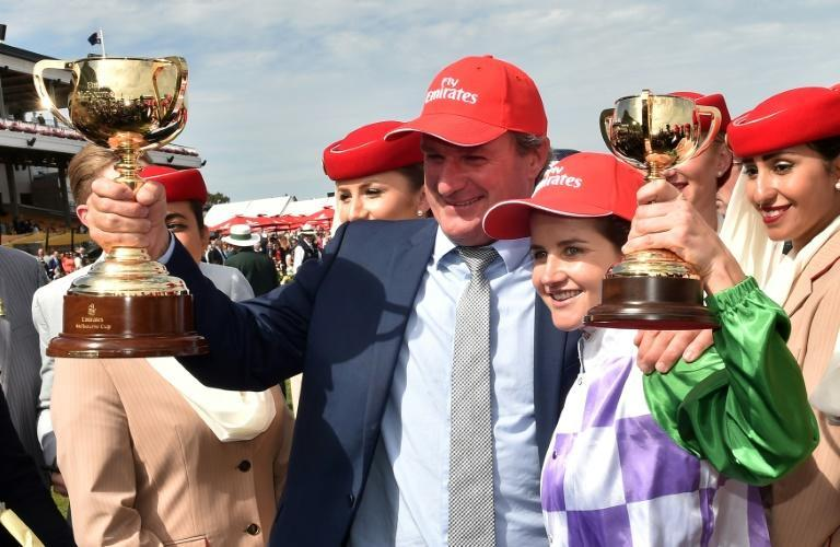 Darren Weir (C) trained Prince of Penzance, which was ridden to victory at the 2015 Melbourne Cup by the first female jockey to win the race, Michelle Payne