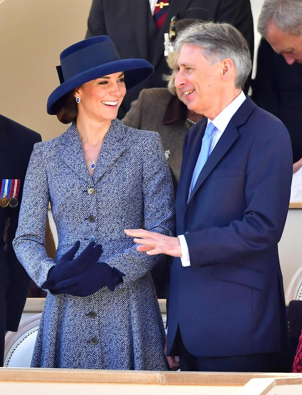 <p>The Duchess re-wore one of her favourite coat dresses for the unveiling of an Iraq and Afghanistan memorial in London. The light blue tweed design is by Michael Kors and was first worn by Kate back in 2014. On this occasion, she paired it with a navy wide-brimmed hat and matching wool gloves.</p><p><i>[Photo: PA]</i> </p>