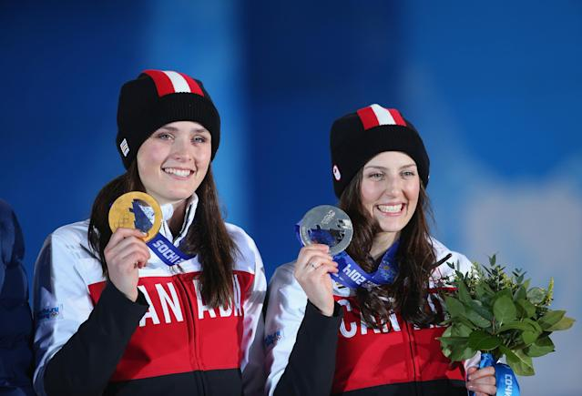 SOCHI, RUSSIA - FEBRUARY 21: (L-R) Gold medallist Marielle Thompson of Canada and silver medalist Kelsey Serwa of Canada celebrate during the medal ceremony for the Women's Ski Cross on day fourteen of the Sochi 2014 Winter Olympics at Medals Plaza on February 21, 2014 in Sochi, Russia. (Photo by Quinn Rooney/Getty Images)