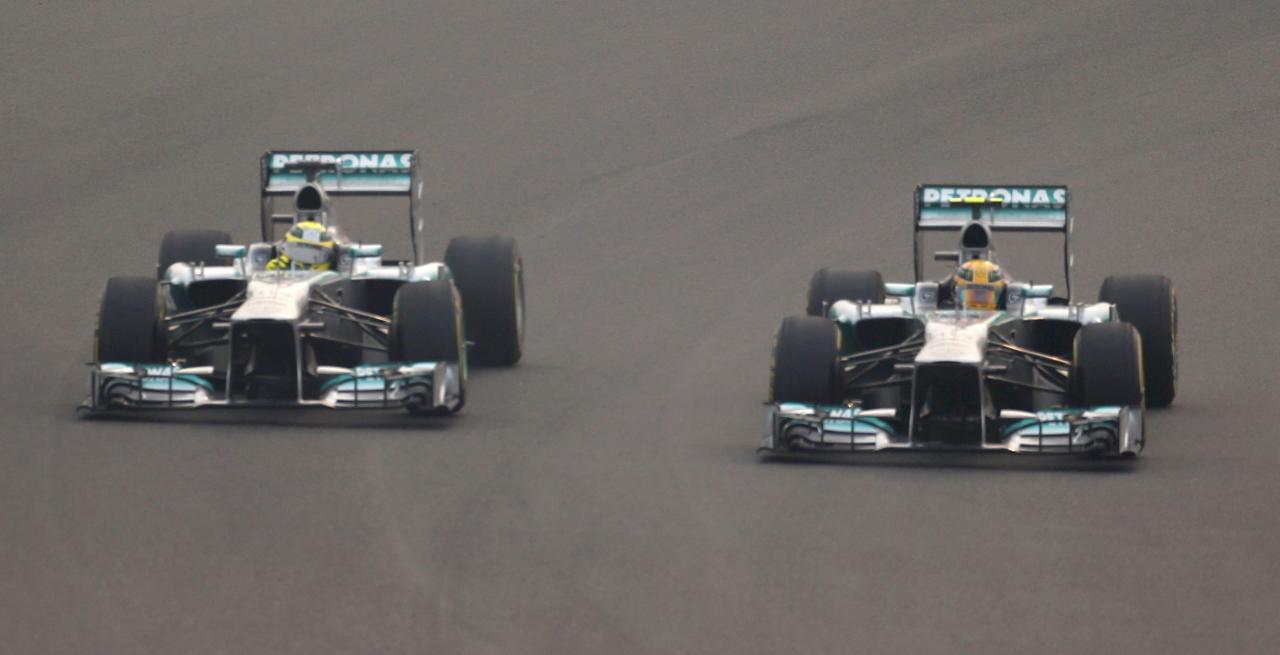 Mercedes Formula One driver Nico Rosberg of Germany (L) and teammate Mercedes Formula One driver Lewis Hamilton of Britain drive during the Indian F1 Grand Prix at the Buddh International Circuit in Greater Noida, on the outskirts of New Delhi, October 27, 2013. REUTERS/Ahmad Masood (INDIA - Tags: SPORT MOTORSPORT F1)