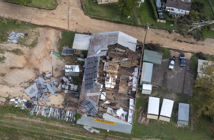 Damage to a roof from Hurricane Laura is seen Friday, Aug. 28, 2020, in Pineville, La., during Gov. John Bel Edwards' aerial tour of stricken areas in the northern part of the state. (Bill Feig/The Advocate via AP, Pool)
