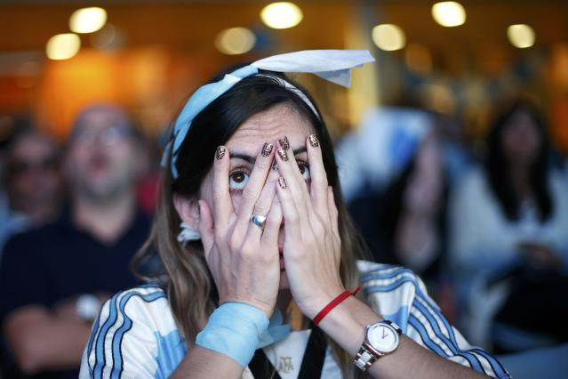 A fan of Argentina reacts while watching a broadcast of the 2014 World Cup final against Germany at the Argentine Embassy in Brasilia, July 13, 2014. REUTERS/Ueslei Marcelino (BRAZIL - Tags: SOCCER TPX IMAGES OF THE DAY SPORT WORLD CUP)