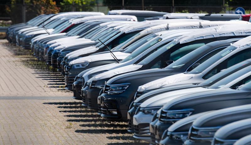 15 May 2020, Lower Saxony, Lehrte: New Volkswagen vehicles are parked in a parking lot of a logistics company. As expected, the Volkswagen Group has come under heavy pressure due to the Corona sales restrictions. The Group brands delivered 473,500 vehicles worldwide in April, 45.4 percent less than in the same month last year. The corona crisis has plunged the entire German economy into recession. Photo: Julian Stratenschulte/dpa (Photo by Julian Stratenschulte/picture alliance via Getty Images)
