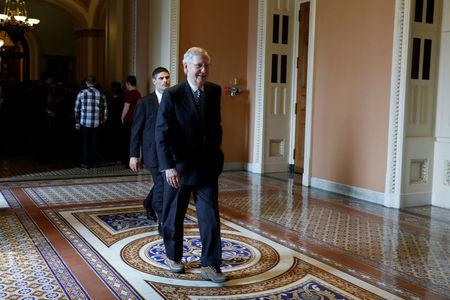 Senate Majority Leader Mitch McConnell departs after speaking with the media following the Republican policy luncheon on Capitol Hill in Washington, D.C., U.S., March 14, 2017. REUTERS/Aaron P. Bernstein