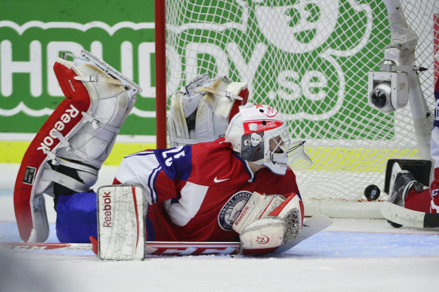 Norway's goalkeeper Henrik Haukeland watches the puck as Sweden scores during their IIHF World Junior Championship Group B preliminary round ice hockey match at Malmo Arena in Malmo, December 29, 2013. REUTERS/Ludvig Thunman/TT News Agency (SWEDEN - Tags: SPORT ICE HOCKEY) ATTENTION EDITORS - THIS IMAGE HAS BEEN SUPPLIED BY A THIRD PARTY. IT IS DISTRIBUTED, EXACTLY AS RECEIVED BY REUTERS, AS A SERVICE TO CLIENTS. SWEDEN OUT. NO COMMERCIAL OR EDITORIAL SALES IN SWEDEN. NO COMMERCIAL SALES