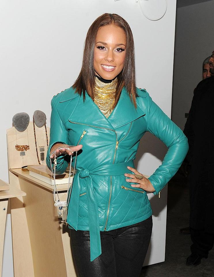 """Brad and Angelina also made headlines recently by designing their own jewelry line, and this week Alicia Keys followed in their footsteps. The R&B singer's collection, called """"The Barber's Daughters,"""" is inscribed with inspirational messages from iconic figures such as Gandhi, Buddha, and Shakespeare. Jason Kempin/<a href=""""http://www.gettyimages.com/"""" target=""""new"""">GettyImages.com</a> - November 24, 2009"""