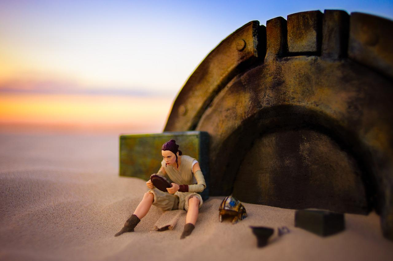 """<p><b>""""</b>I really loved this scene in the movie…. The smooth sand, the sunset, a fallen AT-AT and an unsuspecting Rey in her last moments before she meets BB-8 and everything changes.""""—Brian Winshell (<a href=""""https://www.instagram.com/p/BEm6DRIkYIb/"""">@bwinshell</a>); image co-created bySissy Nunez</p>"""