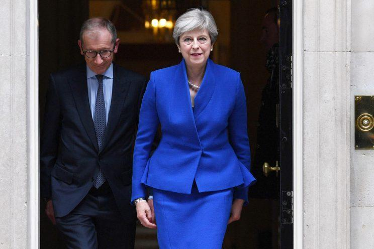 Theresa May leaves Downing Street to seek permission from the Queen to form a government