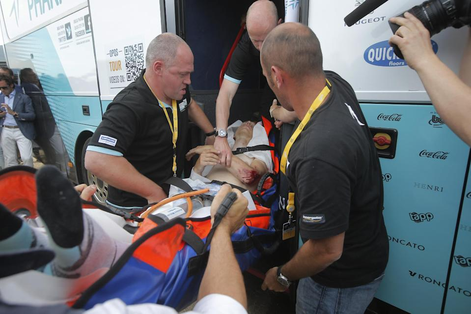 Tony Martin of Germany is taken to an ambulance on the finish line after crashing in the first stage of the Tour de France cycling race over 213 kilometers (133 miles) with start in Porto Vecchio and finish in Bastia, Corsica island, France, Saturday June 29, 2013. (AP Photo/Laurent Cipriani)