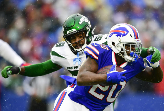 FILE - In this Dec. 29, 2019, file photo, Buffalo Bills running back Frank Gore (20) runs past New York Jets outside linebacker James Burgess (58) during the first half of an NFL football game in Orchard Park, N.Y. The Jets and Burgess have agreed to terms on a one-year deal, agent Drew Rosenhaus told The Associated Press. (AP Photo/David Dermer, File)
