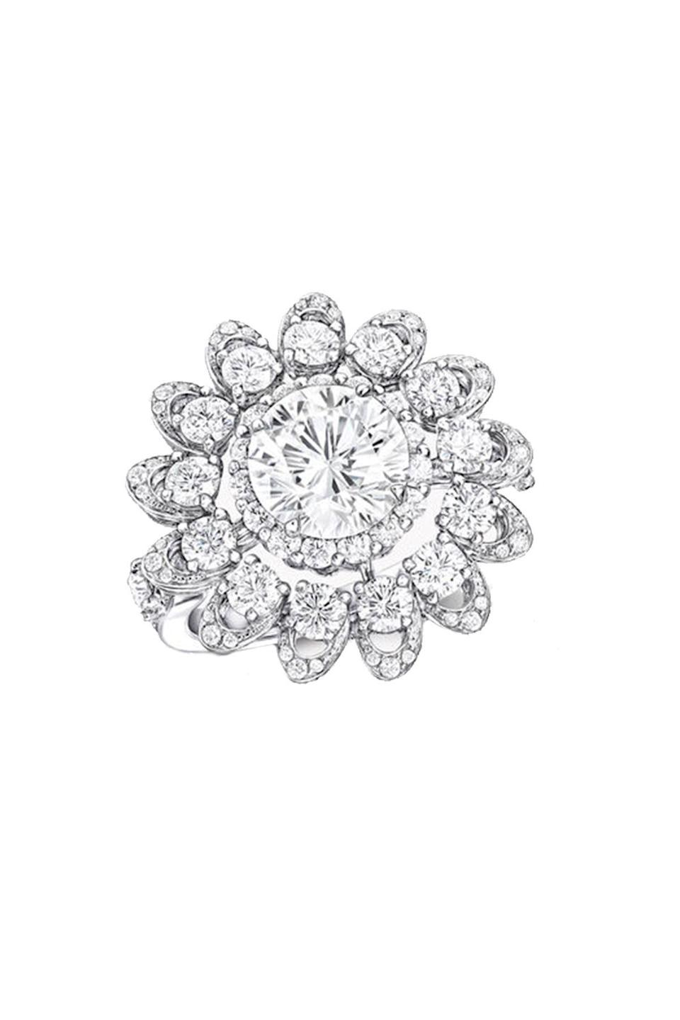 """<p><strong>Graff</strong></p><p>graff.com</p><p><a href=""""https://www.graff.com/us-en/jewellery-collections/view-by-collection/tribal/graff-gateway/graff-gateway-classic-pave-diamond-ring/RGR817_RGR817.html"""" rel=""""nofollow noopener"""" target=""""_blank"""" data-ylk=""""slk:Shop Now"""" class=""""link rapid-noclick-resp"""">Shop Now</a></p><p>Just because she wants a diamond ring doesn't mean she wants the same diamond ring as everyone else. This Graff piece is stunning with a two carat center diamond in a sculptural setting. </p>"""