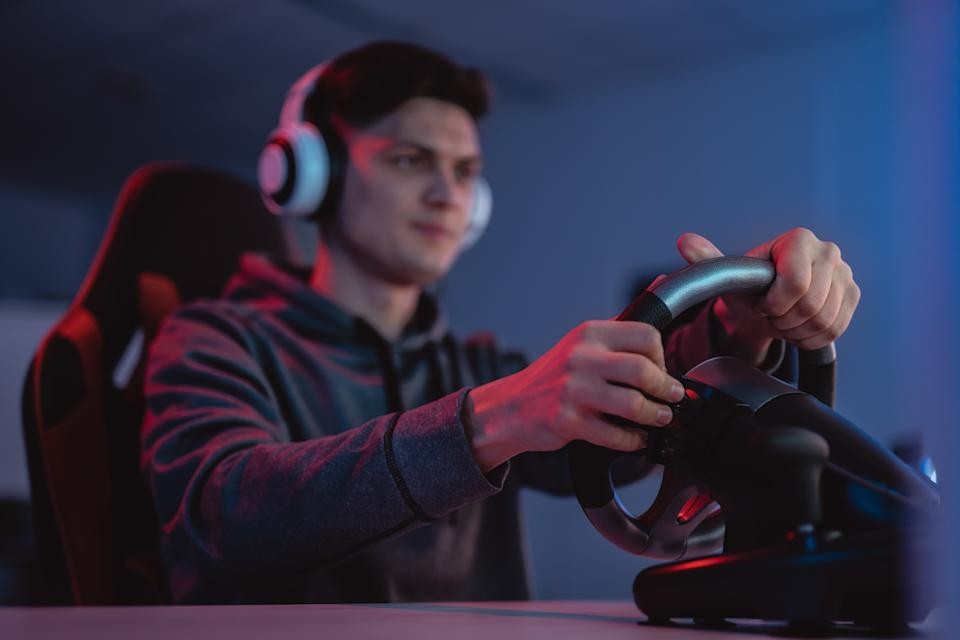 The gamer sitting at the table and playing video games