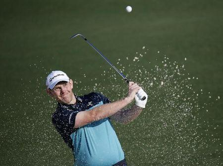 Stephen Gallacher of Scotland hits from a sand trap onto the second green during first round play of the Masters golf tournament at the Augusta National Golf Course in Augusta, Georgia April 9, 2015. REUTERS/Jim Young