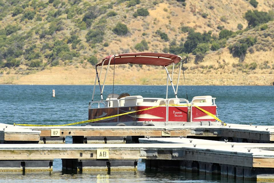 A pontoon boat is docked and roped off with police tape at Lake Piru, where actress Naya Rivera was reported missing Wednesday, on July 8, 2020. According to the Ventura County Sheriff's Department this is believed to the boat that was rented by Rivera.