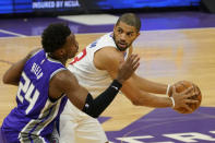 Los Angeles Clippers forward Nicolas Batum, right, looks to pass against Sacramento Kings guard Buddy Hield during the first quarter of an NBA basketball game in Sacramento, Calif., Friday, Jan. 15, 2021. (AP Photo/Rich Pedroncelli)